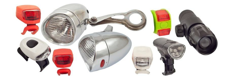 A set of different bicycle headlights on a white background