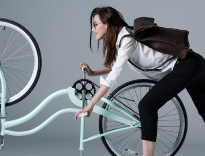 Girl rotating the bicycle pedal